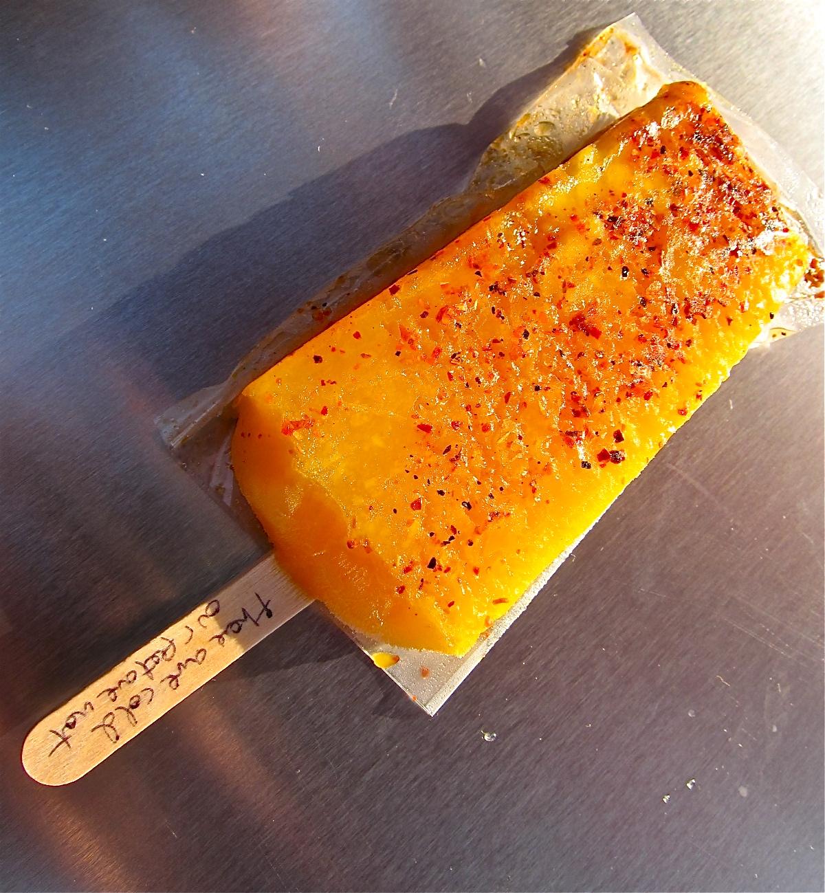 The mango-chile paleta bursts with bright, juicy mango chunks. Spicy ...